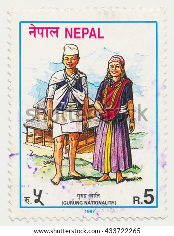 ST. PETERSBURG, RUSSIA - JUNE 8, 2016: A postmark printed in NEPAL, shows Gurung, Traditional costumes, circa 1997 - stock photo
