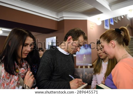 "ST. PETERSBURG, RUSSIA - JUNE 19, 2015: Actor Konstantin Khabensky gives autographs after the children's charity musical ""Mowgli Generation"". The performance is part of the SPIEF 2015"