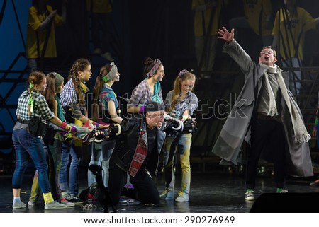 ST. PETERSBURG, RUSSIA - JUNE 19, 2015: Actor Konstantin Khabensky (right) and singer Alexey Kortnev (center) perform in a scene from a children's charity project titled Mowgli Generation - stock photo