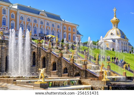 ST PETERSBURG, RUSSIA - JUNE 15, 2014: Peterhof Palace with Grand Cascade. The Peterhof Palace included in the UNESCO's World Heritage List. - stock photo