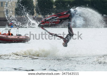 St. Petersburg, Russia - June 7, 2013: Shaw sportsmen racers aquabikes on the Neva River - flips, tricks, Death Defying Acts.