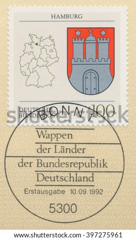 ST. PETERSBURG, RUSSIA - MAR 28, 2016: A first day of issue postmark printed in Bonn, Germany, shows Coats of Arms Hamburg and map of States of the Federal Republic of Germany, circa 1992 - stock photo