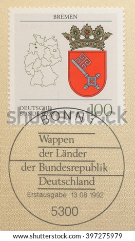 ST. PETERSBURG, RUSSIA - MAR 28, 2016: A first day of issue postmark printed in Bonn, Germany, shows Coats of Arms Bremen and map of States of the Federal Republic of Germany, circa 1992 - stock photo