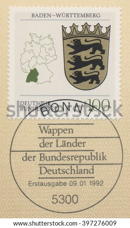 ST. PETERSBURG, RUSSIA - MAR 28, 2016: A first day of issue postmark printed in Bonn, Germany, shows Coats of Arms Baden Wurttemberg and map of States of the Federal Republic of Germany, circa 1992 - stock photo