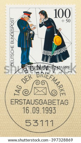 ST. PETERSBURG, RUSSIA - MAR 28, 2016: A first day of issue postmark printed in Bonn, Germany, shows postman, letter and woman, series Postal History, circa 1993 - stock photo