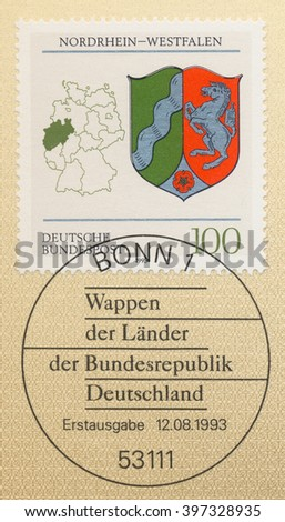 ST. PETERSBURG, RUSSIA - MAR 28, 2016: A postmark printed in Bonn, Germany, shows Coats of Arms North Rhine-Westphalia and map of States of the Federal Republic of Germany, circa 1993 - stock photo