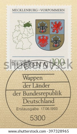 ST. PETERSBURG, RUSSIA - MAR 28, 2016: A postmark printed in Bonn, Germany, shows Coats of Arms Mecklenburg - Western Pomerania, and map of States of the Federal Republic of Germany, circa 1993 - stock photo