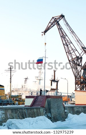 ST. PETERSBURG, RUSSIA - MAR 08: Ceremony of hoisting the national flag of the Russian Federation on the pier in Kronstadt on March 08, 2013 in St. Petersburg, Russia.
