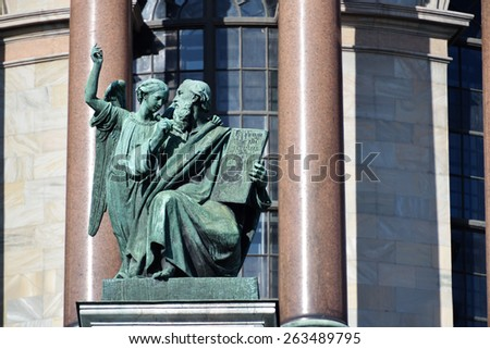 ST. PETERSBURG, RUSSIA - MARCH 5, 2015: Sculpture of apostle Matthew on the St. Isaac's cathedral. Sculptures of apostles for the cathedral created by Giovanni Vitali - stock photo