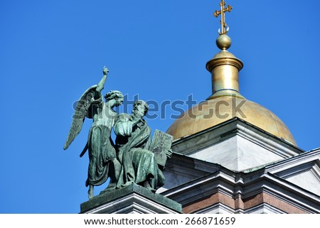 ST. PETERSBURG, RUSSIA - MARCH 5, 2015: Sculpture of apostle Matthew on the St. Isaacs cathedral. Sculptures of apostles for the cathedral created by Giovanni Vitali - stock photo