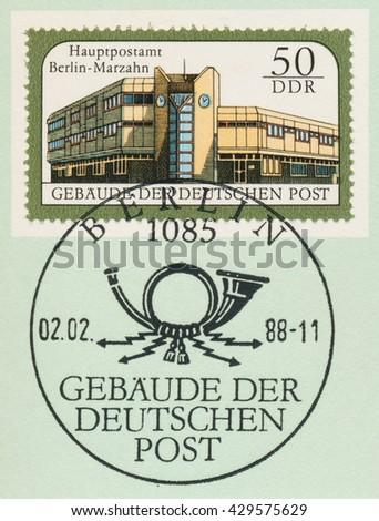 ST. PETERSBURG, RUSSIA - MAY 31, 2016: A postmark printed in DDR, shows General post office, Berlin Marzahn, series Postal Buildings, East Berlin, circa 1988 - stock photo