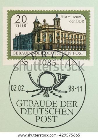 ST. PETERSBURG, RUSSIA - MAY 31, 2016: A postmark printed in DDR, shows National Postal Museum, series Postal Buildings, East Berlin, circa 1988 - stock photo