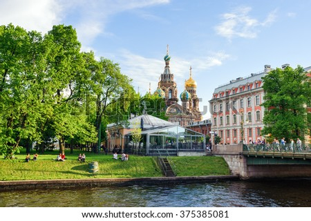 ST PETERSBURG, RUSSIA - May 30, 2015: Church of the Resurrection of Christ (Savior on Spilled Blood) across Mikhailovsky park, St Petersburg, Russia