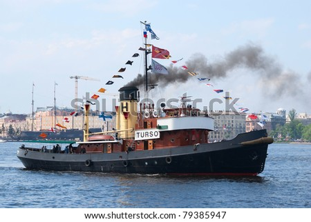 ST. PETERSBURG, RUSSIA - MAY 28: The Turso vintage steamboat navigates Neva river during the celebration of Saint Petersburg 308th anniversary on May 28, 2011 in Saint Petersburg, Russia