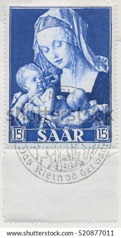 ST. PETERSBURG, RUSSIA - NOV 8, 2016: A postmark printed in SAAR, shows Madonna and Child with pear by Durer (1471-1528), circa 1954