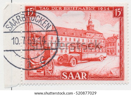 ST. PETERSBURG, RUSSIA - NOV 8, 2016: A postmark printed in SAAR, shows Post Coach and Post Bus of 1920, circa 1954