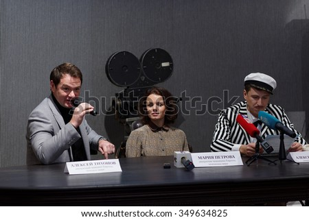 ST. PETERSBURG, RUSSIA - NOVEMBER 25, 2015: Press conference of A. Yagudin (right), M. Petrova, and A. Tikhonov  (left) in the film studio Lenfilm presenting the Christmas shows of Ilya Averbukh - stock photo