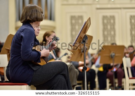 ST. PETERSBURG, RUSSIA - OCTOBER 6, 2015: Musicians of the Andreyev State Russian Orchestra on the rehearsal with Star Sopranos of China in the Philharmonic Hall during the Festival of Chinese music - stock photo