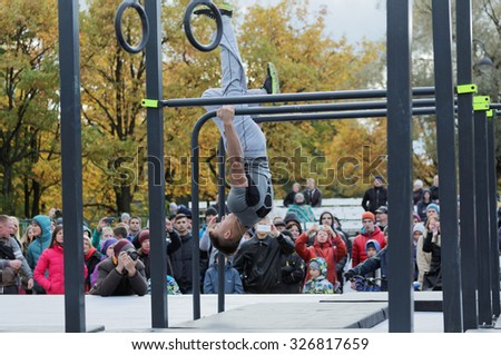 ST. PETERSBURG, RUSSIA - OCTOBER 10, 2015: Unidentified athlete competes in freestyle during the qualifying stage of Street Workout World Cup - stock photo