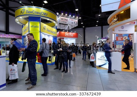 ST. PETERSBURG, RUSSIA - OCTOBER 31, 2015: Visitors in the Expoforum during the Real Estate Fair. It is the largest real estate exhibition in Russia, presenting urban and suburban property - stock photo