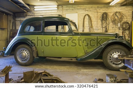 ST. PETERSBURG, RUSSIA - SEPTEMBER 11, 2015: Antique car Adler Trumpf Junior 1937 in the garage before restoration