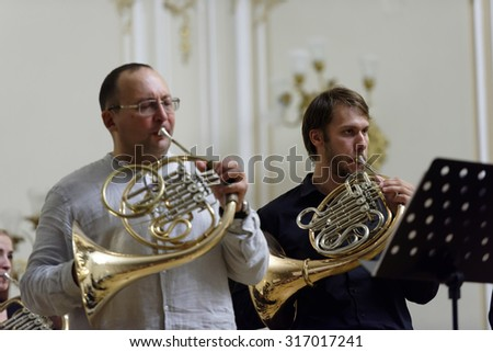 """ST. PETERSBURG, RUSSIA - SEPTEMBER 7, 2015: Musicians of """"Choir of French horns"""" on the rehearsal during the International festival of French horn. The hornfest is held 3rd time - stock photo"""