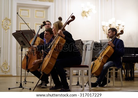 ST. PETERSBURG, RUSSIA - SEPTEMBER 7, 2015: Musicians of the symphonic orchestra Nevsky on the rehearsal during the International festival of French horn. The hornfest is held 3rd time - stock photo