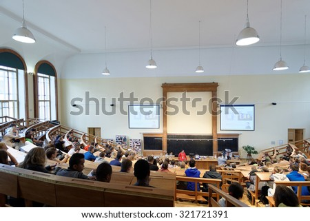 ST. PETERSBURG, RUSSIA - SEPTEMBER 19, 2015: People watching physical show Electricity And Magnetism during PolyFest. It's Europe largest university festival of scientific achievements of young people - stock photo