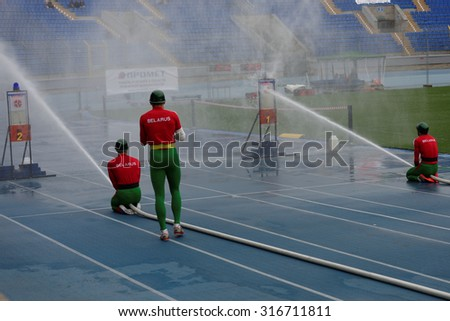 ST. PETERSBURG, RUSSIA - SEPTEMBER 9, 2015: Team Belarus during competitions in combat deployment during the XI World Championship in Fire and Rescue Sport. First World Championship was held in 2002 - stock photo