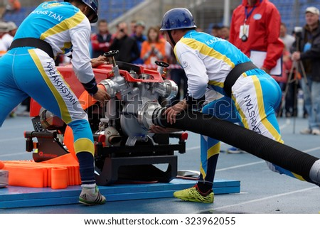 ST. PETERSBURG, RUSSIA - SEPTEMBER 9, 2015: Team Kazakhstan during competitions in combat deployment during XI World Championship in Fire and Rescue Sport. First World Championship was held in 2002 - stock photo
