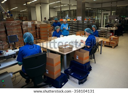 ST. PETERSBURG, RUSSIA - SEPTEMBER 24, 2015: Workers packing the injections in the Solopharm plant. The new pharmaceutical plant was built in accordance with Good Manufacturing Practice standards - stock photo