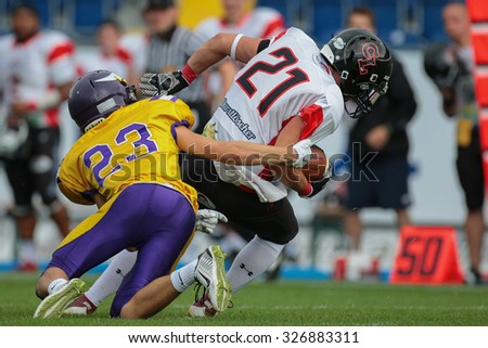 ST. POELTEN, AUSTRIA - JULY 26, 2014: DB Kevin Di Pippo (#21 Lions) intercepts the ball during Silver Bowl XVII. - stock photo