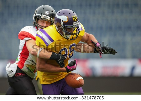 ST. POELTEN, AUSTRIA - JULY 26, 2014: DB Nikolaus Rabitsch  (#17 Lions) strips the ball from WR Sam Hassanein (#88 Vikings) during Silver Bowl XVII. - stock photo