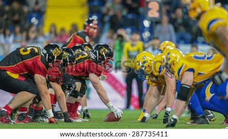 ST. POELTEN, AUSTRIA - JUNE 3, 2014: Team Germany faces Team Sweden at the line of scrimmage during the Football EC European Championchip in St Poelten, Austria. - stock photo