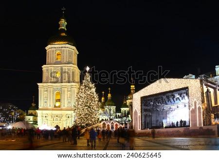 St. Sophia Cathedral, Christmas market, and main Kyiv's New Year tree on Sophia Square in Kyiv, Ukraine - stock photo