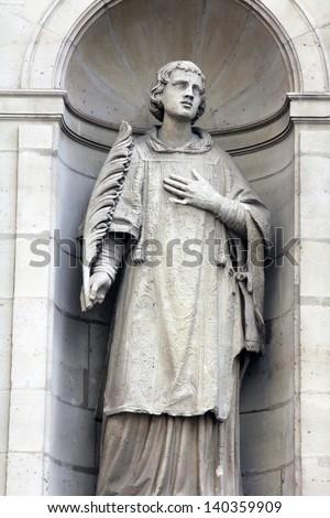 St. Stephen at the facade of the Saint Etienne du Mont Church, Paris. - stock photo