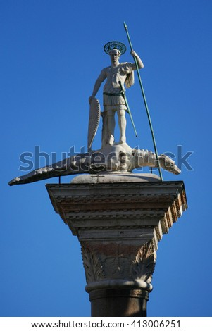 St. Teodoro of Amasea atop its column in Piazzetta (little piazza) San Marco. Venetians will avoid walking between this column and St. Mark's Lion as this was the place where criminals were executed.  - stock photo