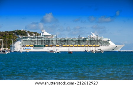 ST. THOMAS - FEB 6: Royal Caribbean cruise ship arrives in St Thomas, US Virgin Islands on February 6, 2010. The island is one of the most popular destinations in the Caribbean - stock photo