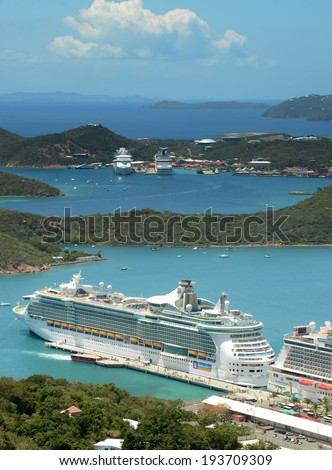 ST THOMAS - MARCH 26: Royal Caribbean Freedom of the Seas visits ST Thomas, US Virgin Islands on March 26, 2014. St Thomas is a popular Caribbean cruise destination - stock photo
