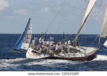 ST. THOMAS, USVI - MARCH 26:  Kioloa races out of Charlotte Amalie Harbor during 2010 International Rolex Regatta in St. Thomas, USVI on March 26, 2010. - stock photo