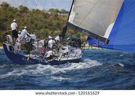 ST. THOMAS, USVI - MARCH 26: TP 52 Vele Veloce races by Great Island in 2010 International Rolex Regatta in St. Thomas, USVI on March 26, 2010. - stock photo