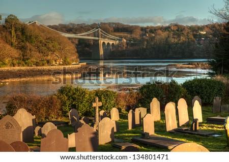 St Tysilio's Church and Graveyard on Church Island Menai Bridge Isle Anglesey North Wales - stock photo
