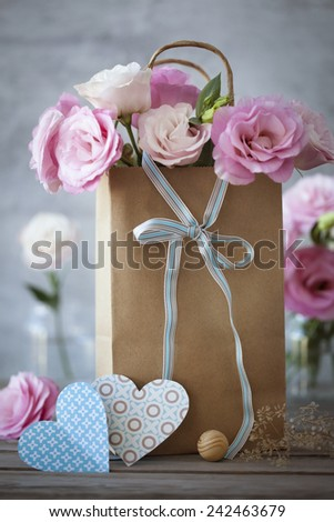 St. Valentines Day background with pink flowers, blue bow and hearts - stock photo