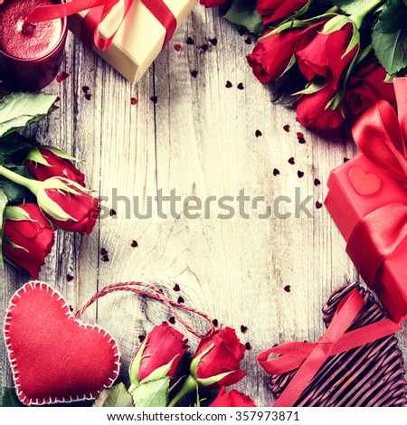 St Valentines frame with bouquet of red roses, decorative hearts and presents. Copy space - stock photo