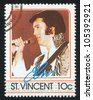 ST. VINCENT - CIRCA 1985: stamp printed by St. Vincent, shows Elvis Presley, American Entertainer, circa 1985. - stock photo