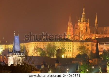 St Vitus Cathedral above the Prague castle in foggy autumn night, Prague, Czech Republic - stock photo
