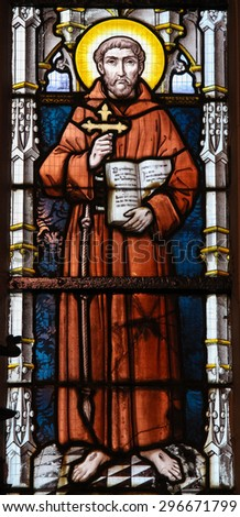 STABROEK, BELGIUM - JUNE 27, 2015: Stained glass window depicting Saint Francis of Asisi in the Church of Stabroek, Belgium. - stock photo