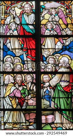 STABROEK, BELGIUM - JUNE 27, 2015: Stained glass window depicting the Resurrection of Jesus in the Church of Stabroek, Belgium. - stock photo