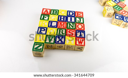 Stack and aligned alphabet wooden block letter set from A to Z. Concept of basic education. Isolated on white background. Slightly de-focused and close-up shot. Copy space. - stock photo