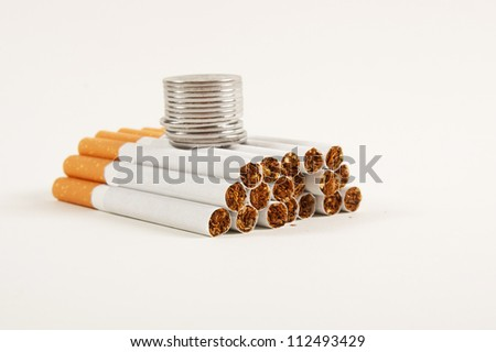stack coins and cigarette - stock photo